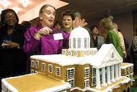 Chancellor Ann Stuart prepares to cut into a cake during the kickoff for Texas Woman's University's centennial celebration in 2001.Dallas Morning News file photo