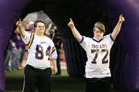 Blake Pyron and Austin Waters show their team spirit Friday at Indian Stadium in Sanger.Maegan Puetz