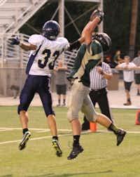 Denton Calvary sophomore Brayden Humphrey (9) makes the catch for a touchdown in Calvary's home opener Friday night.Matt Matthews