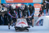 Nick Cunningham, Justin Olsen, former North Texas wide receiver Johnny Quinn and Dallas Robinson start a four-man bobsled run at a World Cup event Jan. 12 in St. Moritz, Switzerland.Arno Balzarini - AP