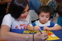 TWU senior K'Leigh Watts helps 3-year-old Nicolas Mejia with a crafts project during a reading program June 27 at Barnes & Noble Booksellers in Denton.Al Key - DRC