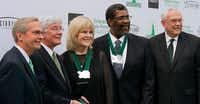 University of North Texas Chancelor Lee Jackson, left, and President V. Lane Rawlins, far right, with Emerald Eagle Honors receipents Johnny Rose, who accepted the award on behalf of the Roy Orbison family, retired Dallas City Manager Mary Suhm, and NFL Hall of Famer Joe Greene during at the Meyerson Symphony Center on Monday, April 15 in Dallas.Jonathan Reynolds - UNT