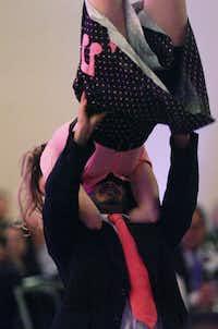 David Morales lifts up Melanie Vest on the dance floor.David Minton - DRC