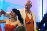 Denton City Council member James King spins dance partner Selina Saenz.David Minton - DRC