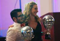"Melanie Vest, DATCU senior vice president and chief financial officer, and her partner, David Morales, hold their mirror ball trophies after winning the ""Dancing With Our Stars"" contest.David Minton - DRC"