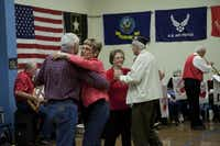 ttendees dance as the Young at Heart band plays during the Veterans Day ceremony at the Denton Senior Center Friday.Bj Lewis