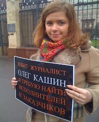 Masha Drokova demonstrates in support of her friend Oleg Kashin, a liberal journalist, in Putin's Kiss.Kino Lorber