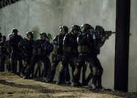Actors portray special forces members raiding the compound of Osama bin Laden in SEAL Team Six: The Raid on Osama Bin LadenNational Geographic Channels