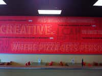 A wall inside Top That! Pizza, located at Rayzor Ranch Marketplace, 2710 W. University Drive, Suite 1030, shows some of the restaurant's mottos.Courtesy photo