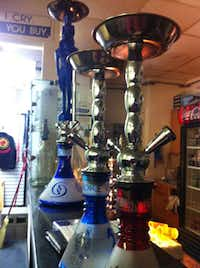 Different sizes of hookahs used for smoking flavored tobacco are shown at the Denton Hookah Lounge.Karina Ramírez - DRC