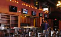 Five large television sets hang over at the bar at Cafe Herrera at 100 Oak St. in Denton.Al Key - DRC