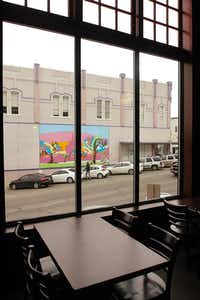 Tall windows by the tables look out over Locust Street at Cafe Herrera in Denton.Al Key - DRC