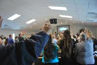 Members of The Rock Church in Justin sing along to hymns led by members of the choir.John D. Harden - DRC