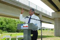 James Fonteno, son of Charlye Heggins, addresses the crowd assembled Friday for the grand opening of the Martin Luther King Jr. Memorial Pedestrian Bridge in Denton.Al Key - DRC