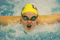Denton freshman Elise Page swims a leg in the girl's 200-yard medley relay at the District 5-4A swimming and diving meet Jan. 26 at the Denton ISD Natatorium. Pageteamed with Bri Broussard, Rachael Crews and Kayla McGill to win the relay at the Region 2-4A meet Saturday in Mansfield.DRC file photo