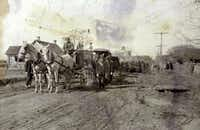 A 1910 photograph that belonged to Erma Peace shows the funeral procession for Rosetta Crawford traveling south on Bell Avenue through Quakertown, Denton's black neighborhood that was razed in the 1920s. The Old Main building of Texas Woman's University can be seen in the background.Denton County Museums - Courtesy photo