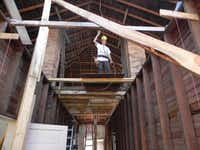A member of the Vietnam Veterans Association Chapter 920 works in the attic of the Green Valley School, which the group has taken on as a renovation project. The 1919 building was falling down when they started, members say.Courtesy photo