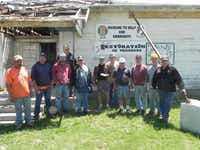 Members of the Vietnam Veterans Association Chapter 920 stand before the old Green Valley School before they started extensive renovations to save it from ruin. So far they have contributed 6,000 man-hours to the project. They need donations of materials and cash before they can finish.Courtesy photo