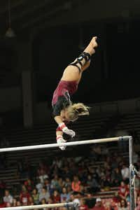 TWU senior Brittainy Johnson performs on the uneven bars Saturday during an NCAA regional meet in Fayetteville, Ark. Johnson scored 9.850 and tied for fourth place.Mark Honbo - Davis Athletic Media Relations