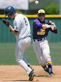 Frisco Lone Star's Trevor Spiker, left, ducks as Sanger's Kyle Stephens turns a double play from second base Saturday at Bronco Field.David Minton - DRC