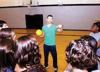 Alejandro Maldonado explains an exercise to students in a Guyer High School physical education class on Monday.Al Key - DRC