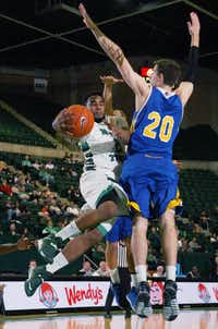 North Texas senior guard Brandon Walton, left, goes to the basket as California-Riverside forward Colin Gruber defends Saturday at the Super Pit.David Minton - DRC