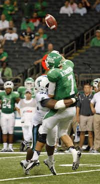 North Texas quarterback Derek Thompson (7) is hit by Tulane defensive end Julius Warmsley on Saturday. The pass was completed for a 62-yard touchdown.Peter Forest - For the DRC