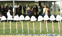 Hard hats and shovels await as the 35Express Groundbreaking ceremony goes on under a tent at Copperas Branch Park on Thursday in Highland Village.Al Key