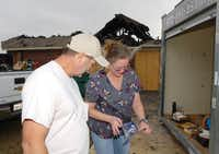 Richard and Carole Pritchett try to salvage some of their belongings Monday after their home on Kildee Trail between Sanger and Bolivar was hit by lightning and destroyed Saturday night as the storms swept through Denton County.Al Key