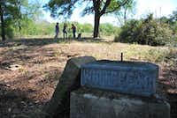 Volunteers help clean up Duck Creek Cemetery last week just outside of Sanger city limits.John Harden