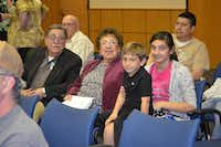 Popo and Lupe González — are accompanied to the presentation by two of their grandchildren in the audience for the formal presentation ceremony before the Denton ISD School Board prior to the start of the meeting (Tuesday, March 19, 2013).Courtesy photo