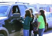 Strickland Middle School students Bailey Wilkerson, Ashlee Bernal, Sara Huggett and Patsy Alonzo explain the message behind Rachel's Challenge to a customer at Chick-fil-A in the Rayzor Ranch shopping center Wednesday afternoon. Students in the school's Rachel's Challenge Club donated $350 worth of free lunches to customers in an effort to spread the organization's message of being kind to others.unknown