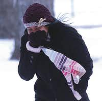 Kayla Joseph, a University of North Texas freshman, crosses the campus in Tuesday's freezing temperatures and gusting winds.