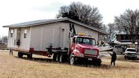 Denton County Housemovers moves a portable classroom building to Selwyn College Preparatory School on Tuesday. The Denton school district is letting Selwyn use six portable buildings while the private school works to rebuild after last week's fire.