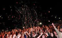 A crowd of thousands cheers as the headlining Flaming Lips perform at North by 35 Conferette in Denton on March 13, 2010.