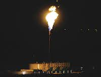 A gas well flare is shown May 7, 2006, on FM1171 and Scenic Drive in Flower Mound.