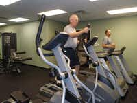 Texas Health Presbyterian Hospital Denton employees George Young, left, and David Layton use the hospital's new fitness facility at the Center for Women.