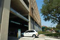Cars enter the new campus parking garage Thursday, the first day of the fall semester at the University of North Texas.