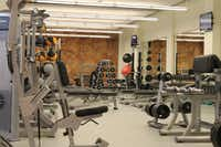 The Texas Woman's University Fitness and Recreation Center includes a   weight room in addition to a cardiovascular exercise room, three group   exercise spaces, an outdoor adventure area, basketball and volleyball   courts and a climbing wall.