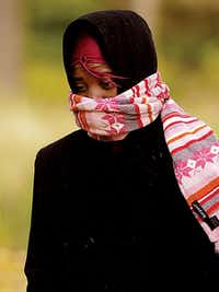 Texas Woman's University senior Natoshia Hamilton was bundled up as she walked across campus in the cold on Monday.