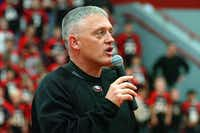 Argyle High School head football coach Todd Rodgers speaks at a pep rally Thursday night at the school.