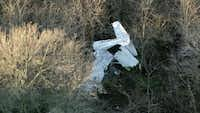 Three people were on board a single-engine Cessna when it crashed just northwest of Denton Airport, killing one.