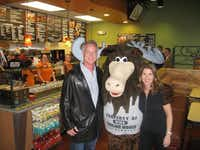 "Former Dallas Cowboy Daryl Peter ""Moose"" Johnston and Jennifer Frank, business partner of the new Smiling Moose Deli which opened at the old Linwood-Alford Florist Building on Friday. The restaurant shares the building with the corporate offices of Verus Real Estate.Karina Ramírez - DRC"