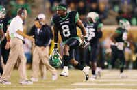 North Texas senior defensive back Marcus Trice (8) celebrates after stopping a Rice drive Oct. 31 at Apogee Stadium.David Minton - DRC