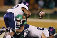 North Texas safety Marcus Trice, second from left, causes a key fumble by Rice running back Charles Ross on Oct. 31.David Minton - DRC